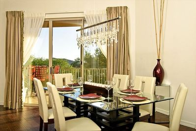 Dining area with sliding doors to the outdoor eating area.
