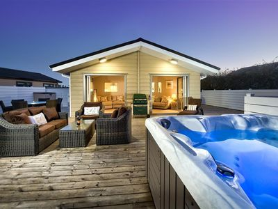 Photo for Featuring a fabulous rear patio with a hot tub, modern outdoor seating and a barbecue, this luxuriou