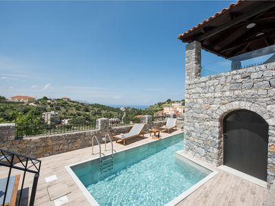 Photo for Villa Acrothea with pool, sea and mountain views, Kournas