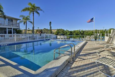 Spend your days lounging around the pristine community pool.