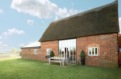 Photo for Thatch barn is surrounded by open countryside, on the edge of the picturesque Norfolk Broads.
