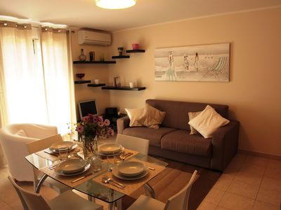 Photo for Modern, functional and welcoming. three-room apartment in the center of Letojan