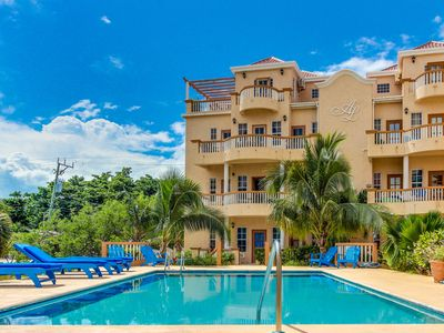 Photo for Spacious beachfront home w/ great views, shared pool and grill!