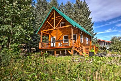 The vacation rental cabin has 3 beds in the loft, 1 bathroom, and sleeps 4!