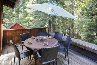 Outdoor deck table and umbrella