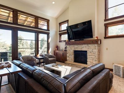 Photo for Mid-mountain luxury townhome, walk to Silver Star lift -- winter shuttle service, on-site concierge