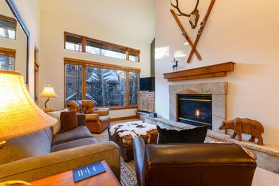 Put your feet up in front of the fireplace in the cozy living area