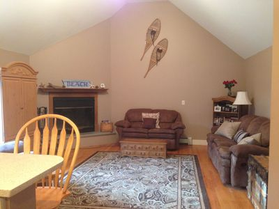 Spacious family room with cable t.v. and XBox 360 w/ games. French doors to deck