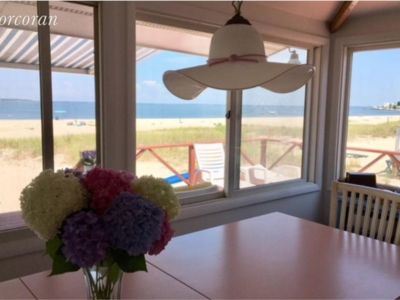 Photo for Southampton beachfront home with hot tub & magnificent sunsets