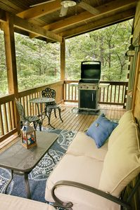You'll find a glider, loveseat, cafe set & gas grill on the top covered deck