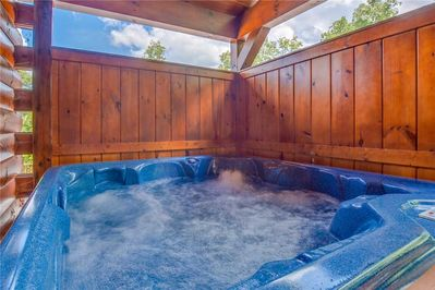 Sheer bliss - A long soak in the deck's hot tub will feel so good when you return from hiking, skiing, or horseback riding—or any other time, really!