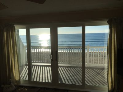 Photo for Beachfront Condo with live entertainment and 7 mile beach steps away