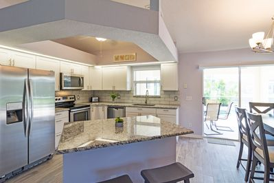 Glimmering kitchen with stainless steel appliances and granite