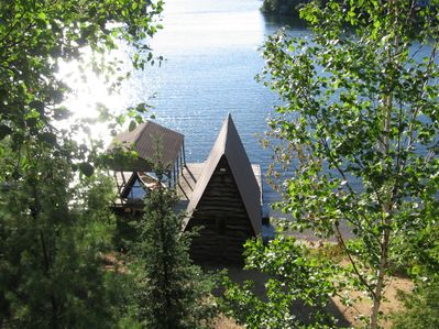 View of dock, boathouse and beach from the deck