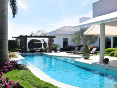 Photo for Jurere Palm Home opens to a beautiful outdoor area with pool, barbecue and chill