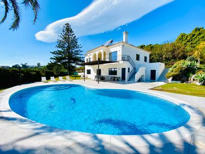 Photo for Spectacular (sea) view villa, beautiful gardens & private swimming pool