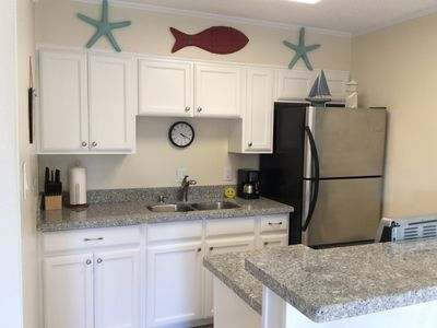 Photo for Ground Floor, Beachside Condo, Steps from pool & beach, tropical retreat