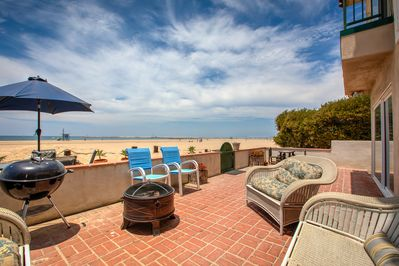 Patio Area - Enjoy unparalleled ocean views from this spacious outdoor patio overlooking the beach.
