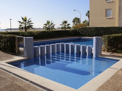 Photo for AT064 STEL: Apartment overlooking the beach with community pool