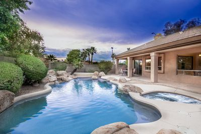 Relax in your private resort style yard with heated pool and spa