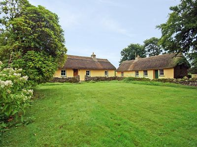 Photo for Detached thatched cottage, quiet and secluded, at the end of long drive in several acres…