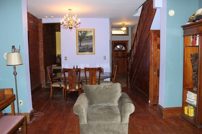 Dining room with wide plank oak floors and original staircase