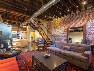 Photo for Striking Three Story Downtown Loft w Private Rooftop Deck and Free Garage Pkg