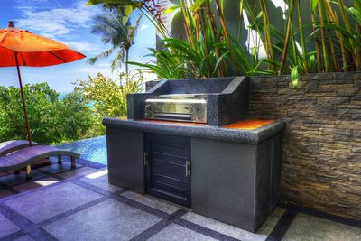 Barbecue located at the poolside