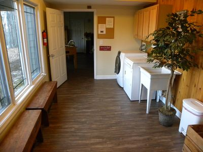 Mud room with washer and dryer, plus benches to take off your ski boots