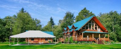The view of the lodge as you swing into our driveway. Wedding tent up for Summer