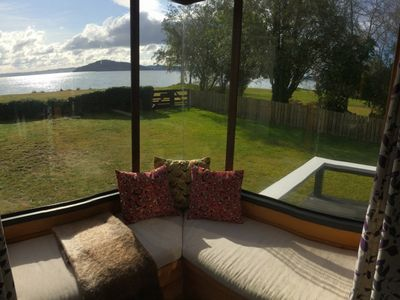 Photo for SEPTEMBER SPECIAL: 25% off! Cosy bach, stunning lakefront site, handy location