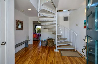Entry way to master bedroom suite downstairs.  Spiral staircase leads to upstairs living area and 2nd master suite.