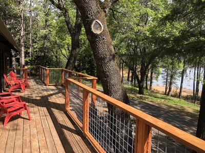 Photo for Lake front house with 1000 sq/ft of decking with unobstructed view of the water.