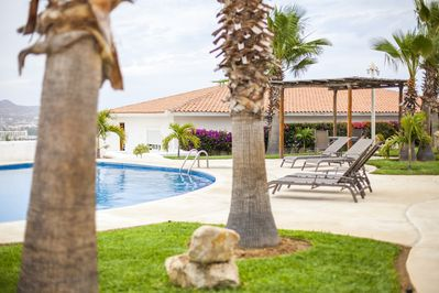 Relax on the lounge chairs next to the pool!
