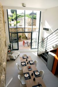 Photo for Stylish and luxurious loft like house in the town of Uzes with a heated pool