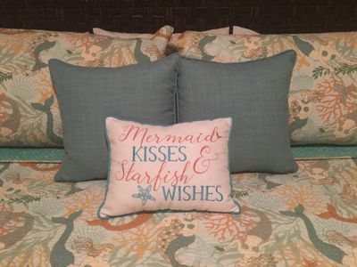 Master w/ king bed is cheerful and beachy. Blackout shades for daytime darkness.
