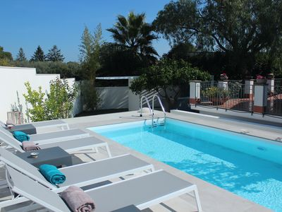 Photo for Panoramic villa overlooking Etna with swimming pool among the scents of a citrus garden