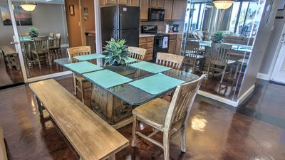 Dining room table seats 7 - 8 and outside seating for 4 more to enjoy meals