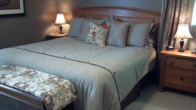 Spacious master bedroom features a King Bed.