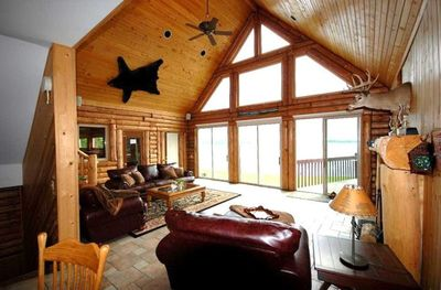 Great Room Features Wood Fireplace, Flat Screen Tv with lake view and patio