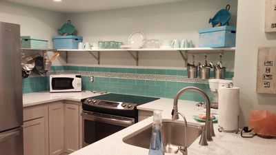 have fun cooking in this bright and cheery beach kitchen ...
