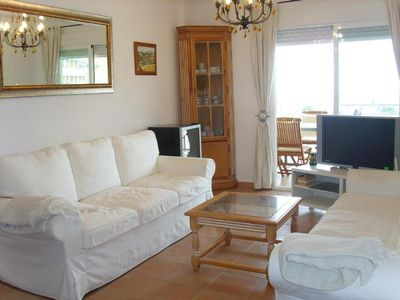 Photo for Apt. 2 bedroom. A / cond. Seaview. 2 dorm. WIFI. Terrace. Gym. Sauna. Pool. Tennis. Golf