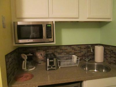 Quartz countertop, stainless steel sink, and aplliances