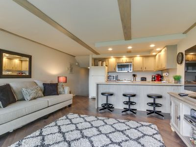 Photo for Dog-friendly condo w/ shared pool & entertainment - walk to beach & downtown!