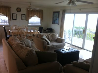 Living room/ dining room facing the water with 9 foot glass doors