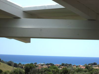 Photo for Comfortable apartment with terrace overlooking the sea, near Villasimius