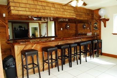 Full Service wet bar with mini fridge and plenty of seating!