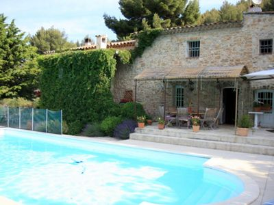 Photo for Provencal farmhouse with private pool with a breathtaking view