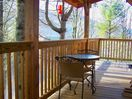 Enjoy your morning coffee while admiring the view on the wraparound deck