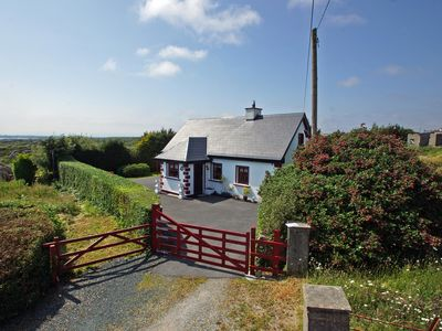 Photo for Detached cottage, in quiet secluded location, on cul-de-sac road leading to the sea and a pier…